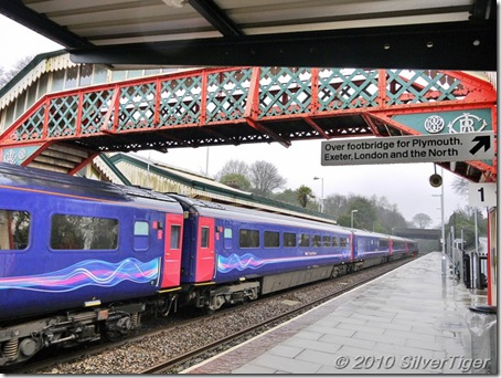 The Paddington train stands in a rain-swept St Austell station