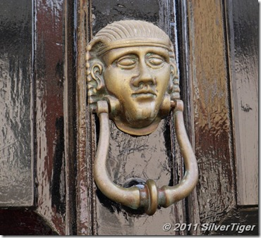 Contented door knocker: sleeping or meditating?