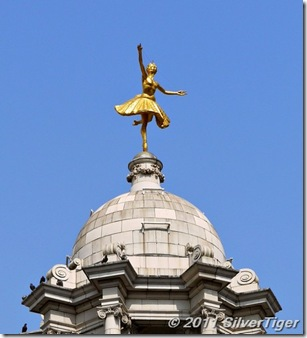 Golden ballerina atop the Victoria Palace