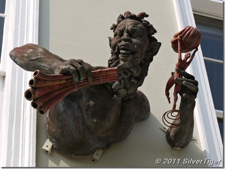 The god Pan (I think) above a shop, Notting Hill