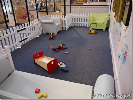 A play area for bored toddlers (and rest area for tired adults!)